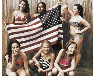 In front are Courtney Gulu, Bailey Marinelli and Zoe Bailey and in back are Mackie Sandquist, Suhad Albaat, Ross Bailey and Kayla Gulu, all enjoying a summer pool party. Taken by Russ Bailey of Austintown.