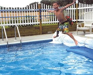 Chase Nelson jumping into Grandma and Pap's pool. Sent by Kathy Mackall of Columbiana.