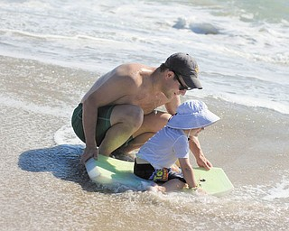Patrick Manning is showing his son, Sam, how to use a Boogie board at Bethany Beach, Del. Taken by Sam's grandmother, Joyce Buzzacco.