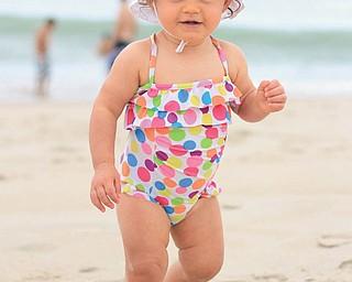 Nina Armeni is taking a walk in the sand at Bethany Beach, Delaware. Taken by Aunt Joyce Buzzacco.