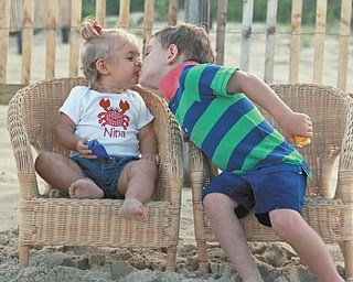 """""""Kissing cousins"""" Sam Manning, 3, and Nina Armeni, 16 months, at Bethany Beach, Del. Taken by Sam""""s grandmother, Joyce Buzzacco."""