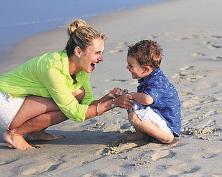 Samantha Manning is having fun with her son Sam at Bethany Beach, Delaware. Taken by Joyce Buzzacco.