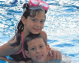 Trystin and Chase Nelson having fun in Grandma and Pap's pool. Sent by Kathy Mackall of Columbiana.