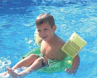 Xavier Nelson riding the waves in Grandma and Pap's pool. Sent by Kathy Mackall of Columbiana.