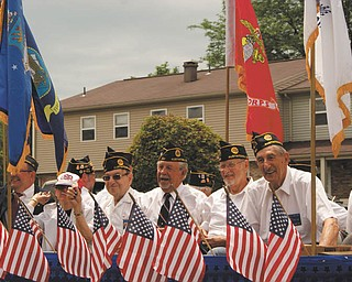 Austintown veterans are smiling while riding in the July 4 parade in Austintown. Sent by Laurie Fox of Lowellville.