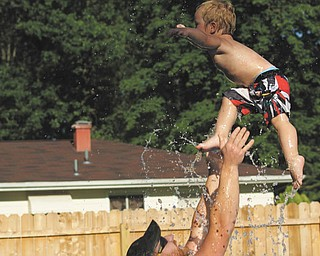 Two-year old Ben Gaither cools off in the family pool and has complete confidence that his dad will catch him.  Ben is the son of Becky and Bill Gaither of Austintown. Sent by Ben's grandma, Laurie Fox.
