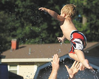 Ben Gaither jumps into his father's arms at the pool. Sent by Ben's grandma, Laurie Fox.