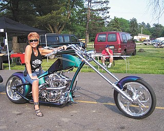"""Nothing better than a custom bike and a warm night for the local bike night! """"Now that's a vacation,"""" says Kelly Morocco at an Ice House Bike Night."""