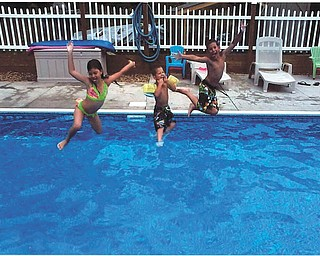 Trystin, Xavier and Chase Nelson, ready and set to go in their grandma and grandpa's pool. Sent by Kathy Mackall of Columbiana.