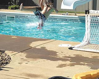 Jacob Buttar of Niles swimming with his waterproof cast!  Sent by his aunt, Rose Marsco.