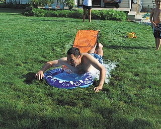 David Buttar of Niles trying to keep up with his son, Jacob!  Sent by Rose Marsco.