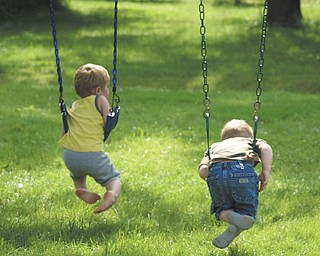Two-year old cousins, Cameron Mason and Ben Gaither, enjoy a hot summer day swinging at the home of grandparents Mike and Laurie Fox in Lowellville. Cameron is the son of Beth and Matt Mason of Salem, and Ben is the son of Becky and Bill Gaither of Austintown. Sent by grandma.