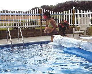 Trystin takes a flying leap into grandma and grandpa's pool. Sent by Kathy Mackall of Columbiana.