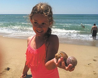 Lilyanah Miller is proud of her new found shells at Nantucket Island.
