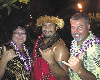 Ray and Mary Lukach  enjoy a luau while on vacation in Hawaii.