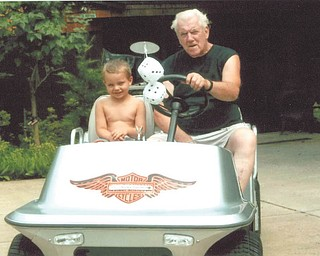 Buck Shipley of Struthers gives his great-grandson, Anthony Shipley, a ride on his antique Harley Davidson 1976 golf cart. Sent by Sue Shipley.