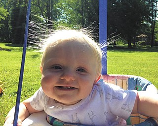 Logan Cheney of Liberty all smiles as he swings in his backyard. Sent by his parents Jason and Amanda.