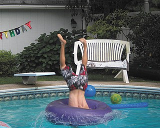 Nick Keshock of Boardman is diving head first into the pool and through the inner-tube at Brian Knotten's birthday party. Taken by Carol Knotten of Boardman.