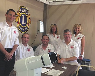 SPECIAL TO THE VINDICATOR The Youngstown Lions Club provided eye screenings for more than 600 people at the Canfield Fair this year. More than 100 of those were encouraged to visit their physicians for follow-up care. In the past, one woman who had the screening was told to visit her doctor and a tumor was found and treated successfully. Some of those who volunteered, from left, are Bill Ruggles and Justin Kuhn of Austintown; Adam Costello of Youngstown,  vice president; Pat Nichols of Liberty; Brian Hughes of Boardman; and Nancy Cuffle of Poland, president.