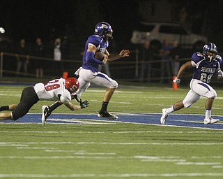 .          ROBERT  K. YOSAY | THE VINDICATOR..Polands #5 Jacob Wolfe -qb on the keeper breaks the last tackle of Struters #28  Anthony Farkas as he goes 61 yards for a TD with him is polands #28 Marion Ramirez ..Poland  vs Struthers @ Poland