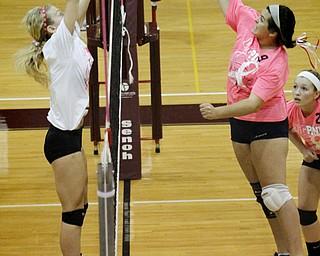 MADELYN P. HASTINGS | THE VINDICATOR..(L-R) Boardman's Amanda Lipke (17) blocks a spike by Fitch's Maura Bianco (9) during their game at Boardman High School on Saturday, October 5, 2013. Boardman won three consecutive games. ... - -30-..