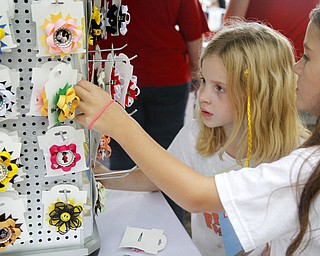 MADELYN P. HASTINGS | THE VINDICATOR..(L-R) Abigal Smolko, 7, and Emily Macik, 8, of Niles admire the 'Sweet Blossoms' bows at the Fall Festival at Stevens Park in Niles on Saturday, October 5, 2013. ... - -30-..
