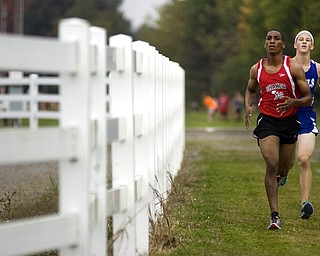 Kelli Cardinal/The Vindicator .Derrian White, a senior from Shaker Heights, keeps a steady pace Saturday ahead of Steve Wahl, a senior from Brunswick, in the boys and girls Division I open race during the Legends Cross Country Meet at Trumbull County Fairgrounds.