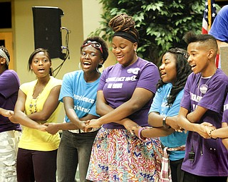 MADELYN P. HASTINGS | THE VINDICATOR..Students of the Sojourner to the Past group hold hands and sing during a rally to kick off nonviolence week in downtown Youngstown on Sunday, October 6, 2013.... - -30-..