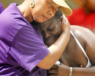 MADELYN P. HASTINGS | THE VINDICATOR..(L-R) Shirlene Hill and Caffie Williams (ok) embrace each other during a rally to kick off nonviolence week in downtown Youngstown on Sunday, October 6, 2013.... - -30-..