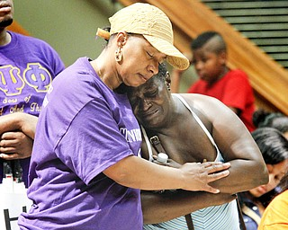 MADELYN P. HASTINGS | THE VINDICATOR..(L-R) Shirlene Hill and Caffie Williams (ok) embrace each other during a rally to kick off nonviolence week in downtown Youngstown on Sunday, October 6, 2013..... - -30-..