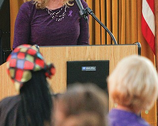 Bridget Mahoney, former WKBN-TV news anchor, talks about her battle to overcome domestic violence. She was the keynote speaker Monday at the Sojourner House Domestic Violence Program and annual vigil.