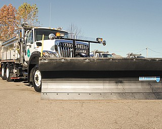 A tow plow is attached to an Ohio Department of Transportation truck as ODOT District 4 unveiled it Wednesday at the Mahoning County garage in Canfield. The tow plow is capable of clearing right and left lanes of roadways simultaneously.