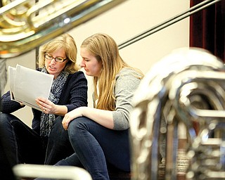 From left Beth and Laura Fox review some of the programs offered at Youngstown State University's Dana School of Music in the Wind Ensemble class. Laura is a senior at North Allegheny High School in Pittsburgh. Students considering attending Dana had the opportunity Wednesday to experience a day at the school, meeting professors and current students and sitting in on rehearsals.