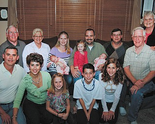 Members of the Schrock family include, front from left, Michael and Michelle Schrock with their three children, Allison and Adam, both 9, and Madison, 12; and David Schrock. In back are, from left, Don and Debbie Schrock; Dawn and Rick Laslow holding their three children, Alyssa and Alonna, 10 weeks, and Danielle, 2; and Jackie Schrock.