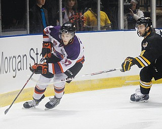Phantoms forward Tyler Spezia (17) eludes Green Bay's Kevin Irwin (14) during their Sept. 28 game at the Covelli Centre.