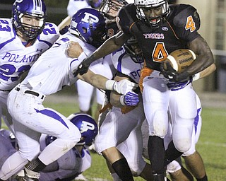 William d. Lewis The Vindicator  Howland's Jaquore Marrs(4) eludes a host of Poland defenders for 1 rst qtr  yardage during 10-11-13 game at Howland.