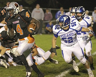 William d. Lewis The Vindicator  Howland's (4) eludes Poland defenders Mike Audi(52) and Austin Wilson(24) for 1 rst qtr  yardage during 10-11-13 game at Howland.
