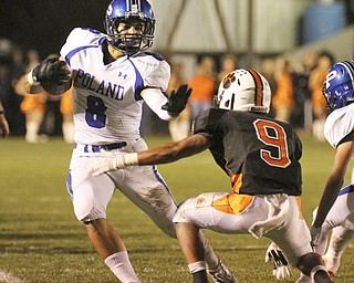 William d. Lewis The Vindicator  Howland's Tre Bryarly(9) tries to stop Poland's  George Chammas(8)  during 10-11-13 game at Howland.