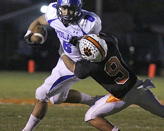 William d. Lewis The Vindicator Poland's (8) eludes  Howland defender (9)  during 10-11-13 game at Howland.