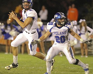 William d. Lewis The Vindicator   Poland QB Jacob Wolfe (5) and Ross Gould (20)during 10-11-13 game at Howland.