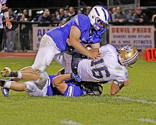 .          ROBERT  K. YOSAY | THE VINDICATOR..sacked and then some as Lowellvilles quarterback is brought down for a big loss during third quarter action by WR  # 54  Parker Clegg and on the bottom #44  Dan Zilke..Lowellville at Western Reserver