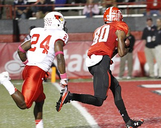 ROBERT K. YOSAY  | THE VINDICATOR..YSU  #80  Andrew Williams cradles  the ball after a 40 yard pass from Hess...and goes in for the score with #24 Mike Banks.. YSU vs Illinois State.. - -30-..