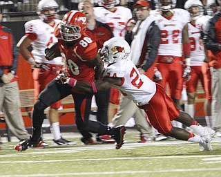 ROBERT K. YOSAY  | THE VINDICATOR..YSU #80  Andrew  Williams aafter catching a 20 yard pass is brought down by   #24 Mike Banks and a first down..YSU vs Illinois State.. - -30-..