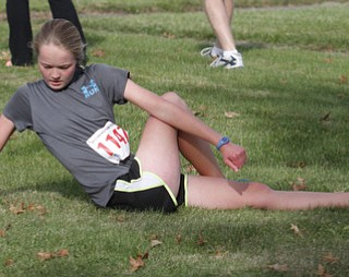 .          ROBERT  K. YOSAY | THE VINDICATOR..pretzel stretch ??  Nadya Stratton of Boardman (ok)  stretches before the race.....The 39th Annual Peace Race -  with over 2000 runners on a beautiful October day