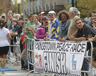 .          ROBERT  K. YOSAY | THE VINDICATOR..well wishers lined the road...and the finish line...The 39th Annual Peace Race -  with over 2000 runners on a beautiful October day