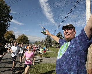 .          ROBERT  K. YOSAY | THE VINDICATOR..helping out the runners with beverages is Rick Dunn of Kirk rd..The 39th Annual Peace Race -  with over 2000 runners on a beautiful October day