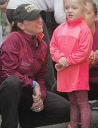 Madison Medvec, 4, of Struthers gets a pep talk from her aunt Terri Hrina-Treharn at Sunday's Peace Race. The day started with a 400-meter kids run at 9 a.m. and was followed by a two-mile run/walk that had 619 participants. In all, more than 2,000 participated Sunday.