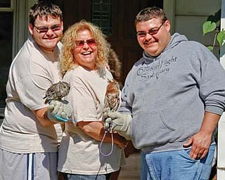 Cameron, Heather and Anthony Merritt, who have owned and operated Birds in Flight Sanctuary for 22 years.