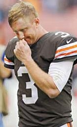 Browns quarterback Brandon Weeden walks off the field after Sunday's loss to Lions in Cleveland. His  backhanded flip to Chris Ogbonnaya was intercepted with 4:36 left, and Detroit rallied to win 31-17.