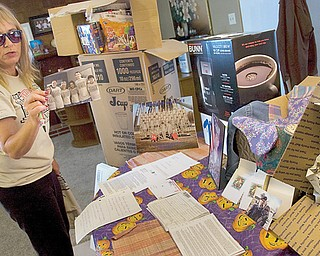 Sandra Emmons of Youngstown shows a photo with members of her family wearing a T-shirt made to get the word out about Support Our Soldiers, a care-package program she started in May after her son was deployed to Afghanistan. Since then, she has sent more than 20 packages to her son, Army Pvt. Michael Bayless, and other military personnel.